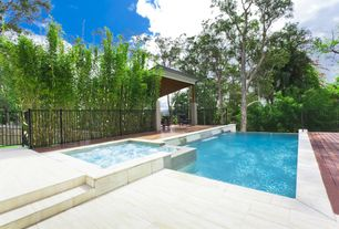 Contemporary Swimming Pool with Gazebo, Fence, Infinity pool, exterior stone floors, Pool with hot tub