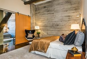 Contemporary Master Bedroom with Barn door, Rove Concepts Egg Chair, Concrete floors, Exposed beam