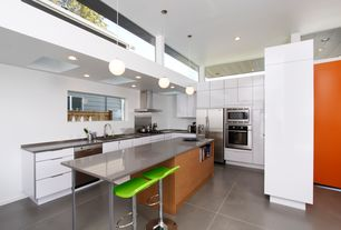 Modern Kitchen with Skylight, Corian counters, Pendant light, High ceiling, Breakfast bar, European Cabinets, U-shaped, Flush