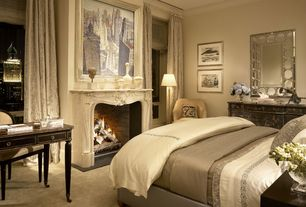 Traditional Master Bedroom with stone fireplace, Built-in bookshelf, Standard height, Casement, Carpet, Crown molding