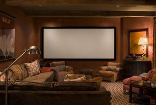 Eclectic Home Theater with Built-in bookshelf, interior wallpaper, Carpet, can lights, Standard height