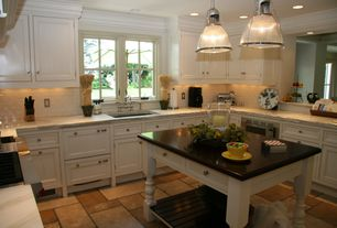 Cottage Kitchen with limestone tile floors, double dishwasher, built-in microwave, Pendant light, Inset cabinets, Casement