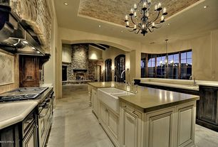 Traditional Kitchen with double oven range, Chandelier, Limestone counters, Undermount sink, French doors, can lights