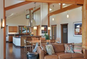 Rustic Great Room with Columns, Cathedral ceiling, Built-in bookshelf, Laminate floors, French doors, Wall sconce