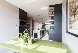 Contemporary Dining Room with Concrete floors, Built-in bookshelf