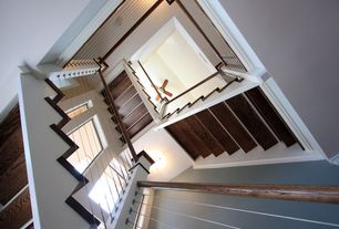 Contemporary Staircase with Hardwood floors, flush light, Cathedral ceiling, Ceiling fan