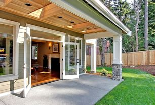 Craftsman Porch with Transom window, Skylight, Casement, Paint, Fence, exterior stone floors, Wrap around porch, French doors
