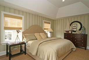 Cottage Guest Bedroom with Laminate floors, Carpet