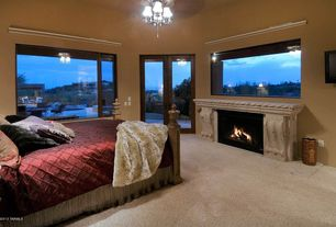 Craftsman Master Bedroom with Standard height, Carpet, Ceiling fan, Cement fireplace, French doors, Fireplace, picture window