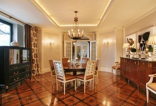 Traditional Dining Room with Laminate floors, Crown molding, Built-in bookshelf, French doors, Chandelier, Transom window