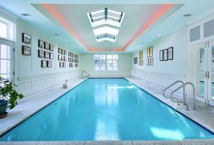 Traditional Swimming Pool with Cove lighting, Paint, Casement, French doors, Indoor pool, exterior stone floors, Skylight