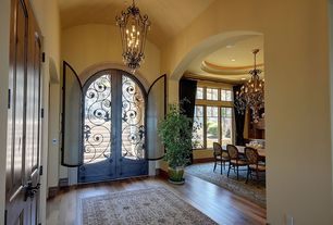 Mediterranean Entryway with Chandelier, High ceiling, Golden lighting 12 light jefferson chandelier, Hardwood floors, Paint 1