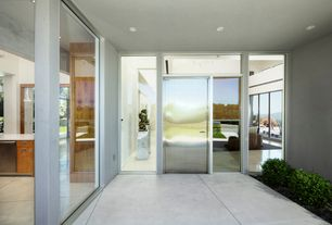 Modern Front Door with exterior concrete tile floors, picture window, Transom window, Pathway, French doors