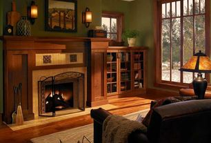 Craftsman Living Room with Built-in bookshelf, Hardwood floors, Wall sconce, metal fireplace