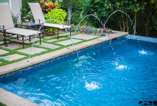 Traditional Swimming Pool with exterior stone floors, Infinity pool