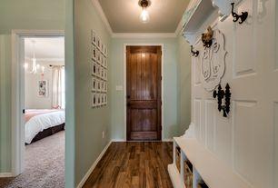 Traditional Hallway with Crown molding, Built-in bookshelf, flush light, specialty door, Hardwood floors