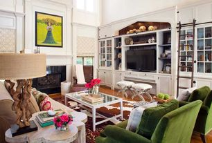 Contemporary Living Room with Cathedral ceiling, Crown molding, Skyline crate armchair - green apple, Built-in bookshelf