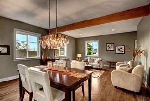 Traditional Great Room with Laminate floors, Standard height, Chandelier, can lights, Casement
