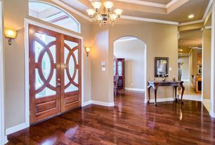 Traditional Entryway with Glass panel door, Chandelier, Crown molding, Wall sconce, Transom window, Hardwood floors