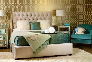 Art Deco Master Bedroom with Clear glass table lamp base, Designers guild porden wallpaper gold, Concrete floors