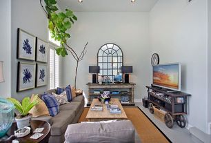 Traditional Living Room with picture window, can lights, Concrete floors, Sunken living room, High ceiling, Casement