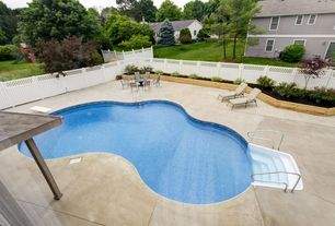 Traditional Swimming Pool with exterior tile floors, Fence, Raised beds