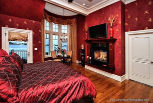 Traditional Master Bedroom with Ceiling fan, High ceiling, insert fireplace, specialty door, can lights, interior wallpaper