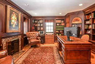 Craftsman Home Office with stone fireplace, Hardwood floors, Crown molding, Built-in bookshelf