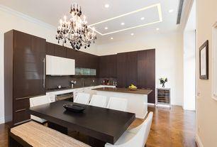 Modern Kitchen with Breakfast nook, Glass panel, European Cabinets, Undermount sink, Sunpan Modern Lucille Arm Chair, Flush