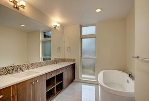 Contemporary Master Bathroom with Freestanding, Ceramic Tile, stone tile floors, double-hung window, Corian counters, Flush