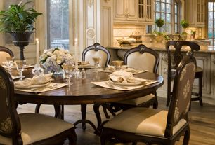 Country Dining Room with Hardwood floors, picture window, Chair rail, Standard height