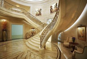 Traditional Staircase with Natural light, Large metal floor vase, flush light, Pedestal table, Crown molding, Round room