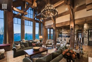 Rustic Great Room with Transom window, Columns, French doors, specialty window, Exposed beam, picture window, Hardwood floors