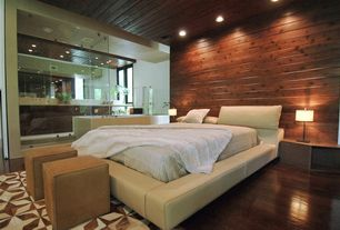Contemporary Master Bedroom with Sam light brown leather ottoman, Hardwood floors, Wood paneling, French doors