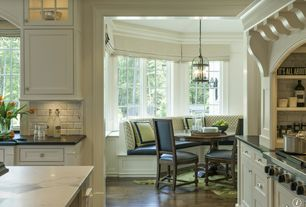 Traditional Dining Room with Quartz countertop in lyra, Hardwood floors, Quartz countertop in atlantis, Crown molding