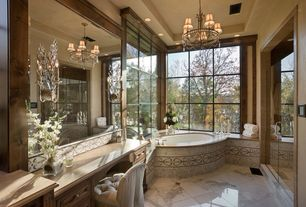 Traditional Master Bathroom with Master bathroom, Limestone counters, Wrought iron crystal chandelier with shades, Chandelier