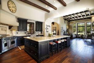 Eclectic Kitchen with Exposed beam, Custom hood, High ceiling, Glass Tile, Casement, Laminate floors, full backsplash