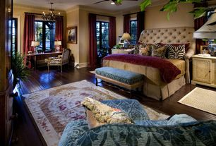 Traditional Guest Bedroom with Crown molding, Hardwood floors, Casement, Paint, Chandelier, Ceiling fan, Standard height