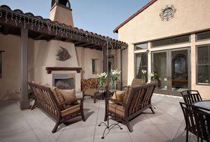 Eclectic Patio with exterior tile floors, Casement, exterior concrete tile floors, Transom window, French doors