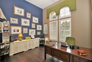 Traditional Home Office with Standard height, Laminate floors, Arched window, specialty window, Built-in bookshelf