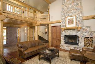 Rustic Living Room with Franklin Austin Loveseat, Natural wood framing, Fireplace, Alpine River Rock, Laminate floors, Carpet