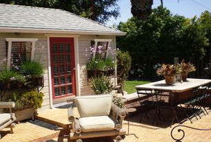 Traditional Patio with French doors, picture window, Brick floors, Wall sconce, Standard height