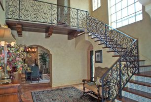 Mediterranean Staircase with High ceiling, Laminate floors