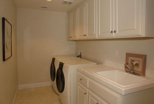Traditional Laundry Room with travertine floors