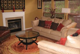 Traditional Living Room with Hardwood floors, Standard height, Fireplace, double-hung window, metal fireplace