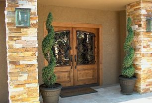 Mediterranean Front Door with exterior tile floors, Spiral Blue Point Juniper, Glass panel door