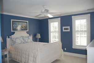 Cottage Guest Bedroom with Concrete floors, Ceiling fan, Four Poster Bed Frame, Interior plantation shutters, Crown molding