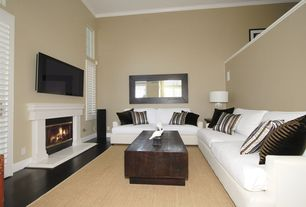 Eclectic Living Room with Standard height, Hardwood floors, Fireplace, specialty window, Louvered door, insert fireplace