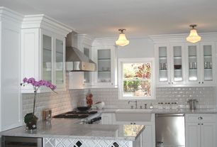Traditional Kitchen with Ms international - turkish carrara white, Partial overlay face frame cabinets, Cup pull hardware