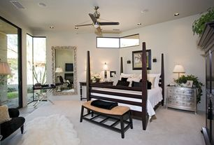 Eclectic Guest Bedroom with Wall sconce, Carpet, Ceiling fan